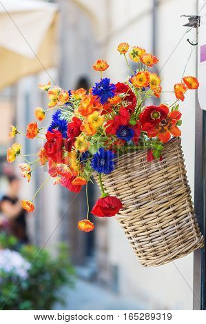 picture of an outdoor hanging basket with artificial flowers