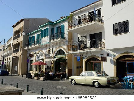 LARNACA CYPRUS - APRIL 7 2016:Shops cafesart galleries and restaurants in old town of Larnaca.It is city on southern coast of Cyprus