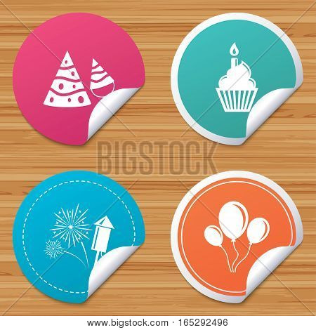 Round stickers or website banners. Birthday party icons. Cake, balloon, hat and muffin signs. Fireworks with rocket symbol. Cupcake with candle. Circle badges with bended corner. Vector