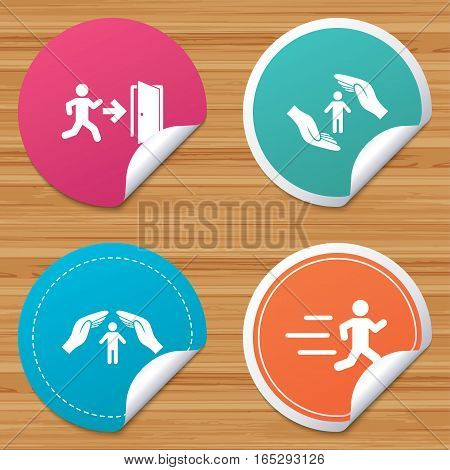 Round stickers or website banners. Life insurance hands protection icon. Human running symbol. Emergency exit with arrow sign. Circle badges with bended corner. Vector
