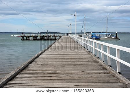 Rhyll Australia - December 29 2016. Old wood bridge pier at Rhyll (Philip Island Victoria Australia). Old wooden jetty with natural background.
