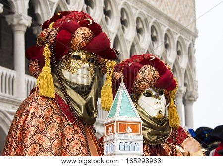 VENICE, ITALY - FEBRAURY 2: Carnival of Venice two beautiful masks in Saint Mark Square FEBRUARY 2, 2016 in Venice, Italy