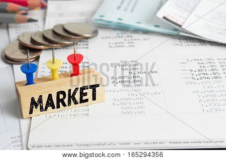 Text message Market on wooden with book back, Finance concept