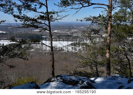 Winter landscape at Sawnee Mountain in North Georgia with Georgia Mountains and snow covered houses on the background
