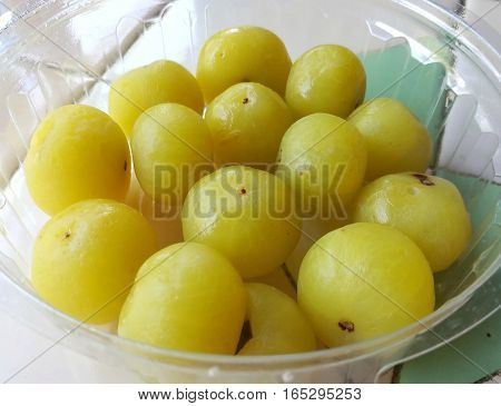 Close up picture of sweet pickled Indian gooseberry