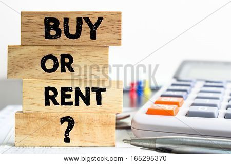 Text message Buy or rent on wooden with office table. Business concept