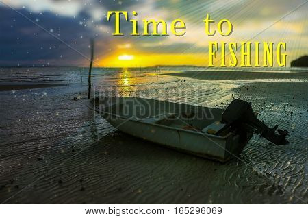 Word Time To Fishing on the background with fishing boat on the beach during sunrise.Fishing concept.