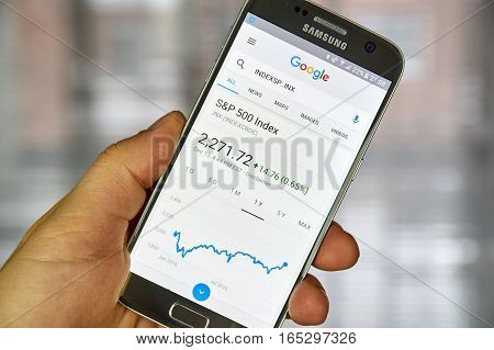 MONTREAL CANADA - DECEMBER 23 2016 : Google Finance page with stock chart and s p 500 index on Samsung S7 screen.