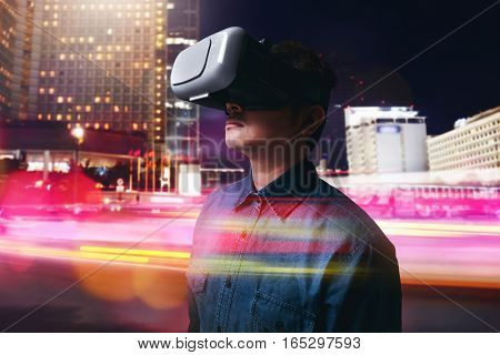 Man wearing virtual reality goggles high tech