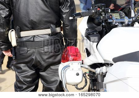 Back view of Japanese police motorcycle and police man