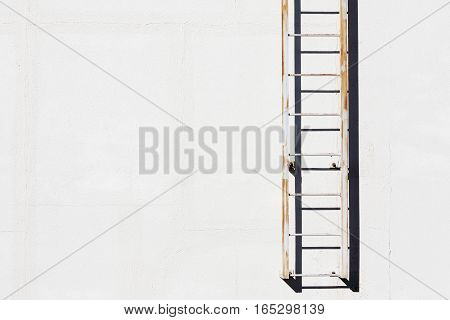 simple metal ladder on cement wall, architectural background