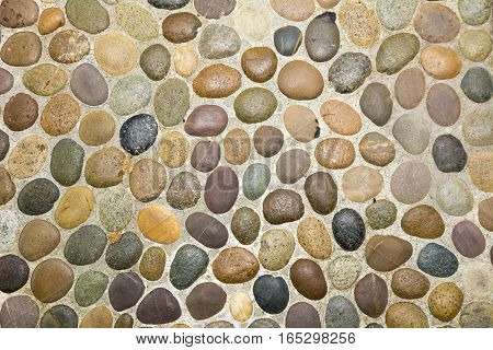 Wall round stone rock texture use for background