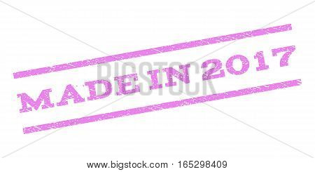 Made In 2017 watermark stamp. Text caption between parallel lines with grunge design style. Rubber seal stamp with dirty texture. Vector violet color ink imprint on a white background.
