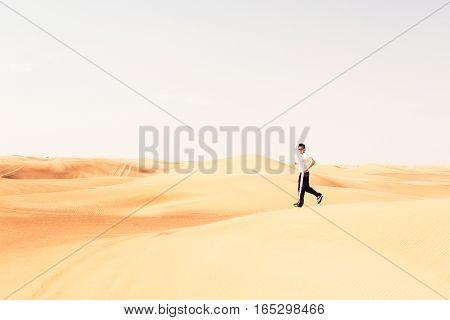 Extreme sports - a runner jogging through the desert.