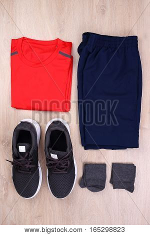 Running clothes collection on wooden background, Running clothes