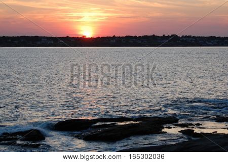 Sunset over the Narragansett Bay from Beavertail Lighthouse in Jamestown, RI