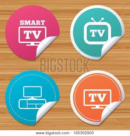 Round stickers or website banners. Smart TV mode icon. Widescreen symbol. Retro television and TV table signs. Circle badges with bended corner. Vector