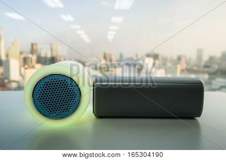 bright and modern wireless speaker with light on table