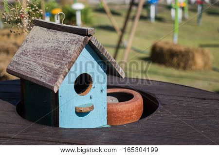 Wooden bird house decorated on the table stock photo