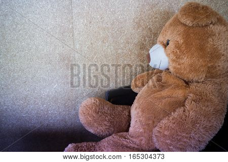The doll bear waiting on black sofa stock photo