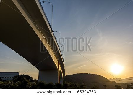Viaduct under sky at sunset in Tokushima, Japan