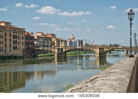 travel to Italy - Arno River with Ponte alla Carraia bridge in Florence city