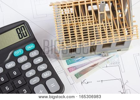 House Under Construction, Calculator And Polish Currency On Electrical Drawings, Concept Of Building