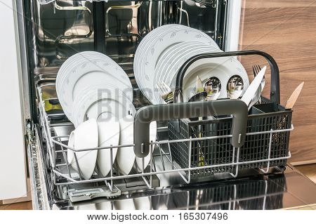 Open Dishwasher With Clean Dishes After Cleaning Process