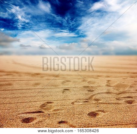 beautiful sandy surface of the desert under sunny cloudy sky