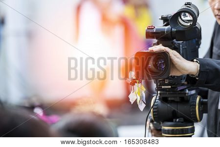 Video camera operator working with his equipment