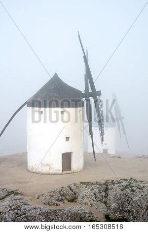 Windmills in a thick fog in Castilla-La Mancha, Spain