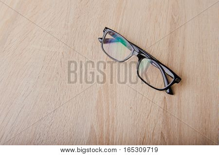Clear Eyeglasses Glasses With Black Frame Fashion Vintage Style On Wood Desk