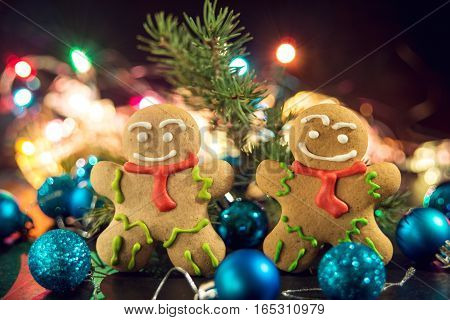 gingerbread man near Christmas tree with toys by garland the concept of Christmas