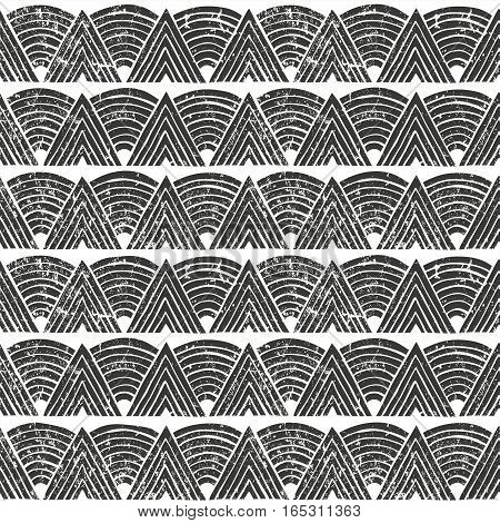 Seamless tribal pattern with grunge effect. Hand drawn background. EPS10 vector illustration in linocut style.