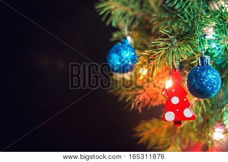 Christmas baubles on a fir tree branch with garland Christmas theme