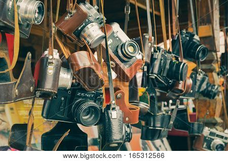 MOSCOW, RUSSIA - August 19, 2016. Vintage film cameras with covers on exhibition-fair