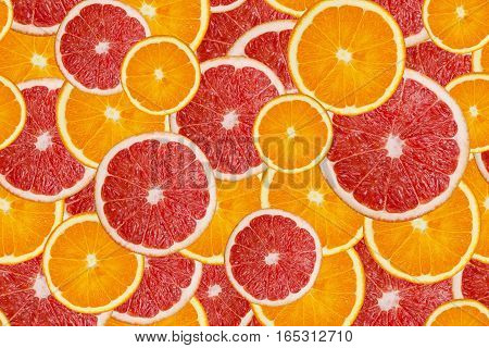 Slices of fresh orange and grapefruit texture background seamless pattern