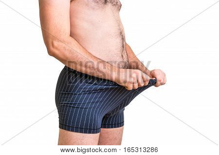 Attractive Man Is Looking In His Boxer Underwear