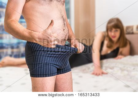 Woman In Bed And Man In Underwear Showing Thumb Up