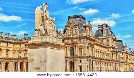 Paris, France - July 08, 2016 : Louvre Museum In Paris With Tourists On Street. The Louvre Is The Bi