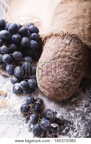 Bread with grapes. Dark bread. Background with bread