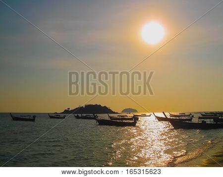 Small boats at the Andaman Sea at sunset