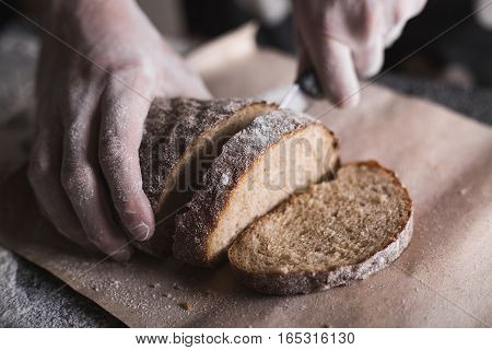 Man cutting bread. Bread. Background with bread