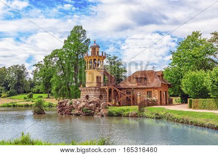 Versailles, France - July 02, 2016 :lighthouse On The Lake In  Hamlet Queen Marie Antoinette's Estat