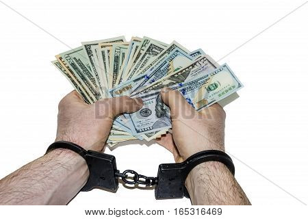 Hands in handcuffs holding dollars, isolated on white background