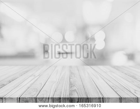 White wood table top with blurred defocus backgrounds