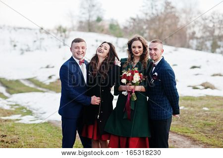 Cheerful Best Mans With Bridesmaids On Winter Wedding Day.