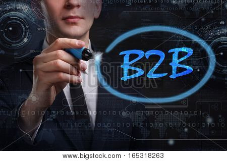 Business, Technology, Internet And Network Concept. Young Business Man Writing Word: B2B