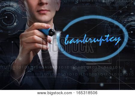 Business, Technology, Internet And Network Concept. Young Business Man Writing Word: Bankruptcy