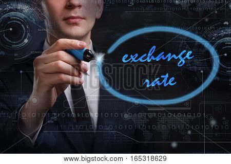 Business, Technology, Internet And Network Concept. Young Business Man Writing Word: Exchange Rate